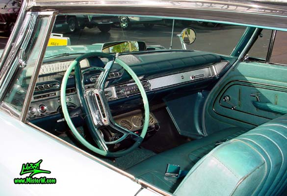 Photo of a turquoise 1961 Dodge Polara 4 door hardtop station wagen at the Scottsdale Pavilions Classic Car Show in Arizona. Interior of a 1961 Dodge Polara station wagen