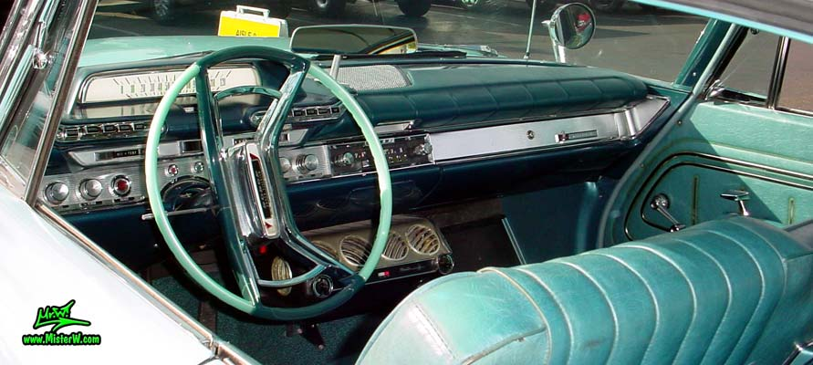 Photo of a turquoise 1961 Dodge Polara 4 door hardtop station wagen at the Scottsdale Pavilions Classic Car Show in Arizona. Dash board of a 1961 Dodge Polara station wagen