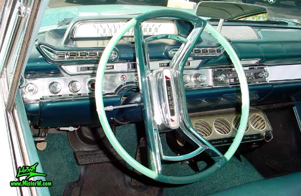 Photo of a turquoise 1961 Dodge Polara 4 door hardtop station wagen at the Scottsdale Pavilions Classic Car Show in Arizona. Odometer of a 1961 Dodge Polara station wagen