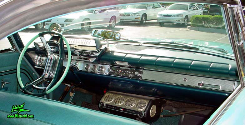 Photo of a turquoise 1961 Dodge Polara 4 door hardtop station wagen at the Scottsdale Pavilions Classic Car Show in Arizona. Interior, dash & odometer of a 1961 Dodge
