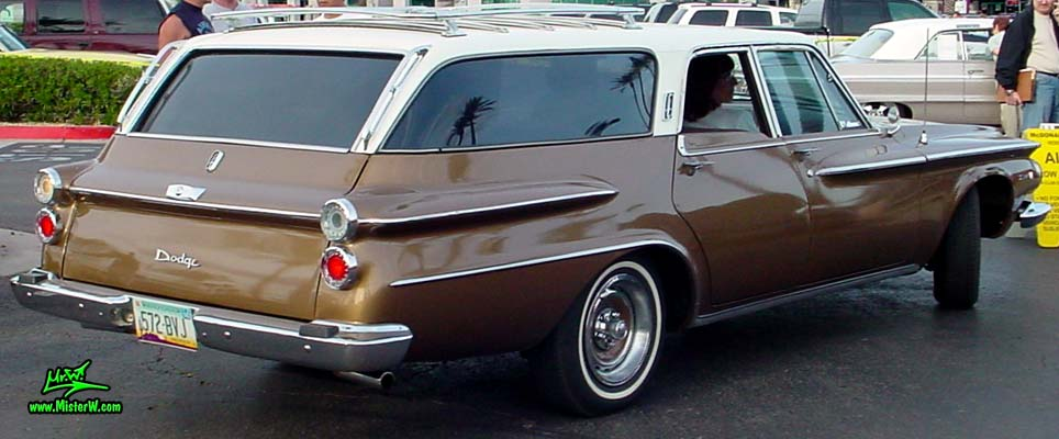 Photo of a brown 1962 Dodge Dart 4 door station wagen at the Scottsdale Pavilions Classic Car Show in Arizona. Sideview of a 1962 Dodge Dart station wagen