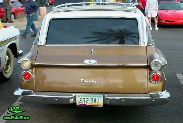 Photo of a brown 1962 Dodge Dart 4 door station wagen at the Scottsdale Pavilions Classic Car Show in Arizona. Rearview of a 1962 Dodge Dart station wagen