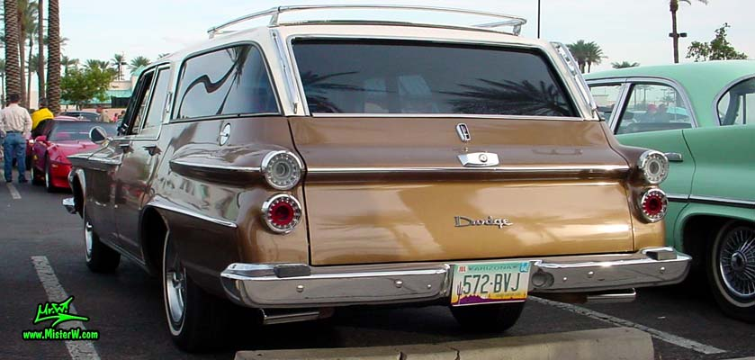 Photo of a brown 1962 Dodge Dart 4 door station wagen at the Scottsdale Pavilions Classic Car Show in Arizona. 62 Dodge station wagen rear door, tail lights & fins