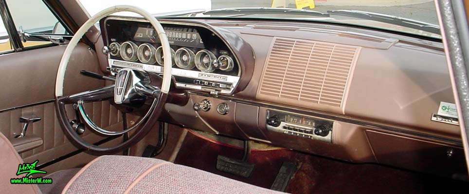 Photo of a brown 1962 Dodge Dart 4 door station wagen at the Scottsdale Pavilions Classic Car Show in Arizona. Dashboard of a 1962 Dodge Dart