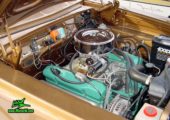 Photo of a brown 1962 Dodge Dart 4 door station wagen at the Scottsdale Pavilions Classic Car Show in Arizona. Engine bay of a 1962 Dodge Dart station wagen