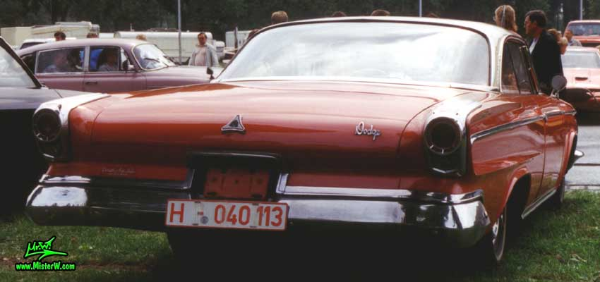 Photo of a red 1963 Dodge 2 Door Hardtop Coupe at a Classic Car Meeting in Germany. 1963 Dodge Tail Fins