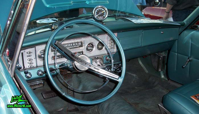 Photo of a blue metallic 1964 Dodge 2 door post coupe at the Scottsdale Pavilions Classic Car Show in Arizona. Interior of a 1964 Dodge Coupe