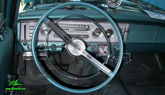 Photo of a blue metallic 1964 Dodge 2 door post coupe at the Scottsdale Pavilions Classic Car Show in Arizona. Dashboard & speedometer of a 1964 Dodge