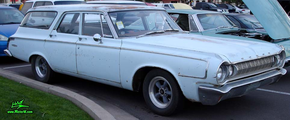 Photo of a bright blue 1964 Dodge 4 door station wagon at the Scottsdale Pavilions Classic Car Show in Arizona. 64 Dodge Stationwagon