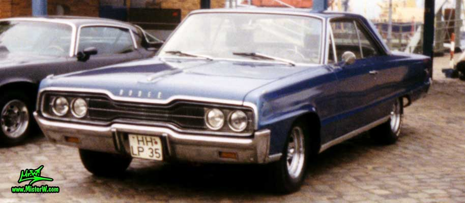 Photo of a blue 1966 Dodge 2 Door Hardtop Coupe at a Classic Car Meeting on the St. Pauli Fischmarkt in Hamburg, Germany. 66 Dodge