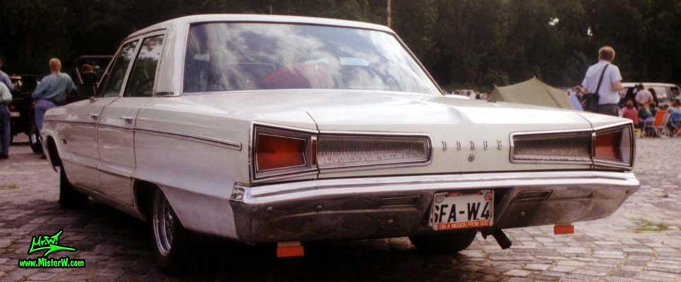 Photo of a white 1966 Dodge 4 Door Hardtop Sedan at a Classic Car Meeting in Germany. 66 Dodge Sedan
