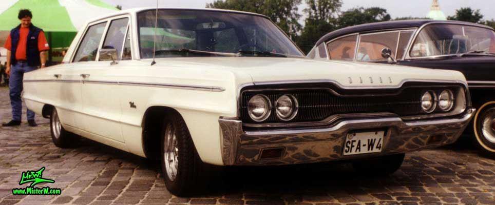 Photo of a white 1966 Dodge 4 Door Hardtop Sedan at a Classic Car Meeting in Germany. 1966 Dodge Chrome Grill