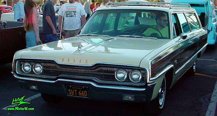 Photo of a white 1966 Dodge 4 Door Station Wagon at the Scottsdale Pavilions Classic Car Show in Arizona. 66 Dodge Wagon