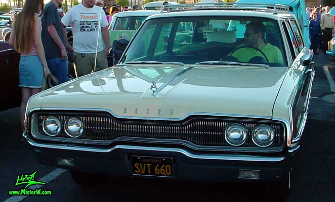 Photo of a white 1966 Dodge 4 Door Station Wagon at the Scottsdale Pavilions Classic Car Show in Arizona. 1966 Dodge Station Wagon Frontview