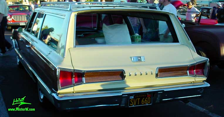 Photo of a white 1966 Dodge 4 Door Station Wagon at the Scottsdale Pavilions Classic Car Show in Arizona. 1966 Dodge Station Wagon Rearview