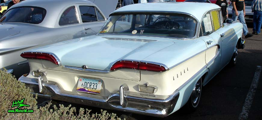 Photo of a turquoise & white 1958 Edsel Ranger 4 Door Sedan at the Scottsdale Pavilions Classic Car Show in Arizona. 1958 Edsel Rearview