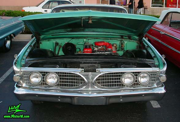 Photo of a green metallic 1960 Edsel Ranger 2 Door Sedan at the Scottsdale Pavilions Classic Car Show in Arizona. 60 Edsel Ranger with open hood