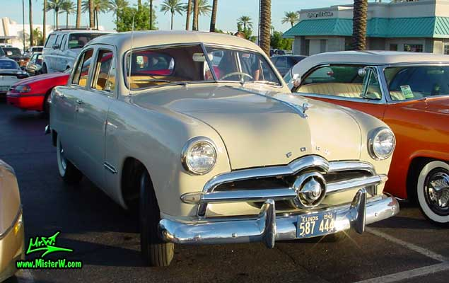 Photo of a grey 1949 Ford 4 Door Hardtop Sedan at the Scottsdale Pavilions Classic Car Show in Arizona. grey 1949 Ford Sedan