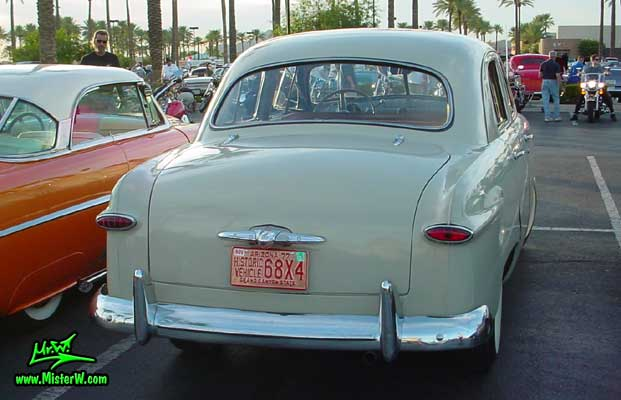 Photo of a grey 1949 Ford 4 Door Hardtop Sedan at the Scottsdale Pavilions Classic Car Show in Arizona. grey 49 Ford