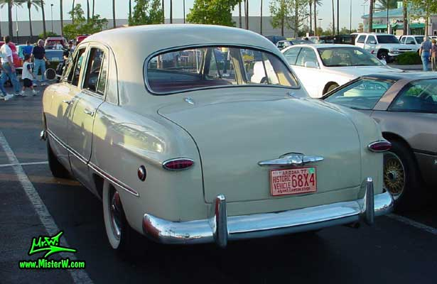 Photo of a grey 1949 Ford 4 Door Hardtop Sedan at the Scottsdale Pavilions Classic Car Show in Arizona. Photo of a 1949 Ford