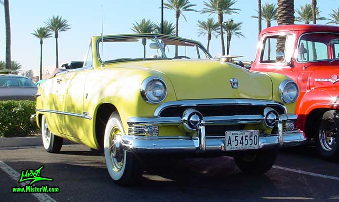 Photo of a yellow 1951 Ford Convertible at the Scottsdale Pavilions Classic Car Show in Arizona yellow 1951 Ford Convertible