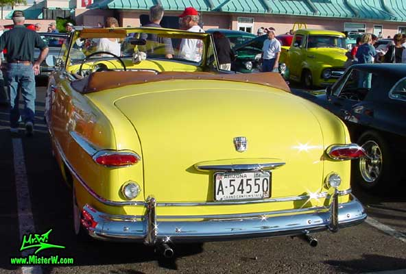 Photo of a yellow 1951 Ford Convertible at the Scottsdale Pavilions Classic Car Show in Arizona photo of a yellow 1951 Ford Convertible