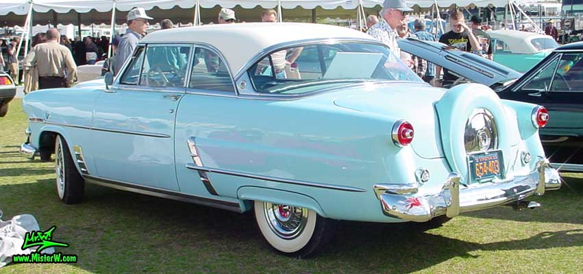 Photo of a bright blue 1953 Ford Crestline Victoria 2 Door Hardtop Coupe at a classic car auction in Scottsdale, Arizona. 1953 Ford