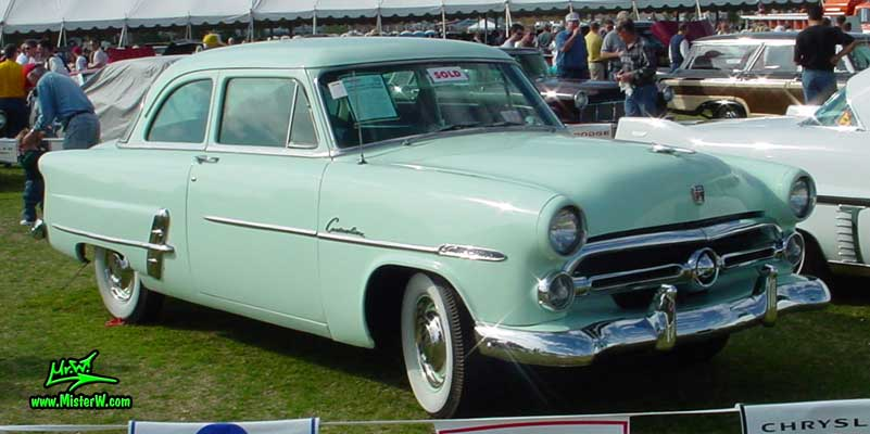 Photo of a jade green 1953 Ford Custom Line 2 Door Hardtop Coupe at a classic car auction in Scottsdale, Arizona. 1953 Ford Custom
