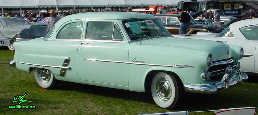 Photo of a jade green 1953 Ford Custom Line 2 Door Hardtop Coupe at a classic car auction in Scottsdale, Arizona. Sideview of a 1953 Ford