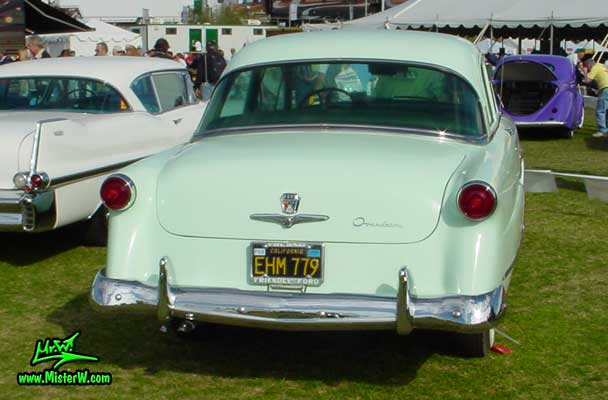Photo of a jade green 1953 Ford Custom Line 2 Door Hardtop Coupe at a classic car auction in Scottsdale, Arizona. Rear of a 1953 Ford