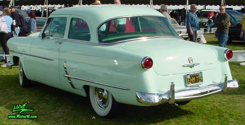 Photo of a jade green 1953 Ford Custom Line 2 Door Hardtop Coupe at a classic car auction in Scottsdale, Arizona. Ford