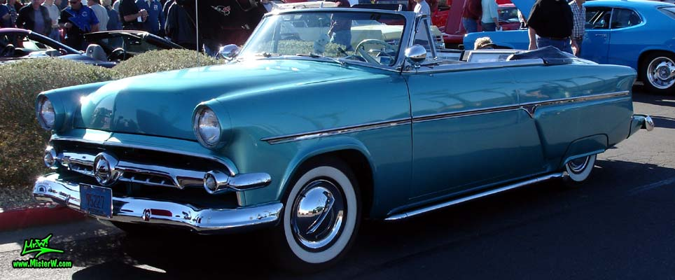 Photo of a blue metallic 1954 Ford Crestline Convertible at the Scottsdale Pavilions Classic Car Show in Arizona. 54 Ford Crestline Convertible