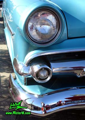 Photo of a blue metallic 1954 Ford Crestline Convertible at the Scottsdale Pavilions Classic Car Show in Arizona. 1954 Ford Crestline Head Light