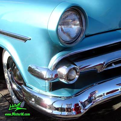 Photo of a blue metallic 1954 Ford Crestline Convertible at the Scottsdale Pavilions Classic Car Show in Arizona. 1954 Ford Front Chrome Grill