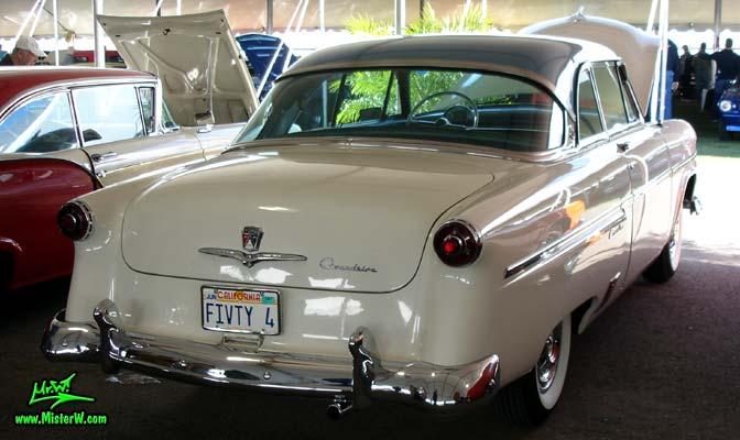 Photo of a white 1954 Ford Crestline 2 Door Hardtop Coupe at a classic car auction in Scottsdale, Arizona. Rearview of a 1954 Ford Crestline Coupe
