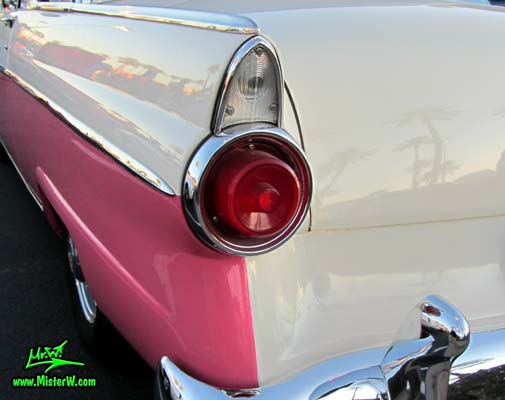 Photo of a pink & white 1955 Ford Crown Victoria 2 Door Hardtop Coupe at the Scottsdale Pavilions Classic Car Show in Arizona. 55 Ford Crown Victoria Coupe Tail Light & Fin