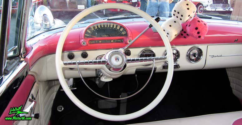 Photo of a pink & white 1955 Ford Crown Victoria 2 Door Hardtop Coupe at the Scottsdale Pavilions Classic Car Show in Arizona. Speedometer of a 55 Ford Crown Victoria Coupe