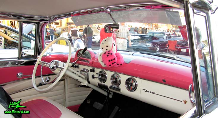Photo of a pink & white 1955 Ford Crown Victoria 2 Door Hardtop Coupe at the Scottsdale Pavilions Classic Car Show in Arizona. Dashboard of a 1955 Ford Crown Victoria Coupe