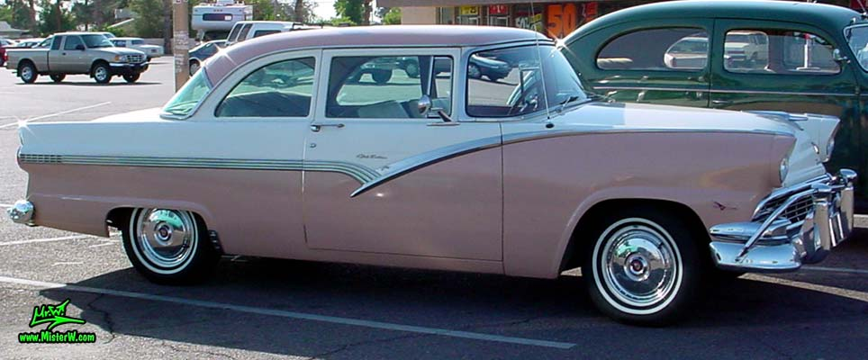 Photo of a white & pink 1956 Ford Fairlane 2 Door Post Club Sedan at a classic car meeting in Phoenix, Arizona. Sideview of a 56 Ford Fairlane Club Sedan