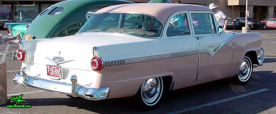 Photo of a white & pink 1956 Ford Fairlane 2 Door Post Club Sedan at a classic car meeting in Phoenix, Arizona. Tail Fins of a 56 Ford Fairlane 2 Door Post
