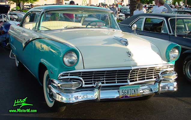 Photo of a white & turquoise 1956 Ford Fairlane 2 Door Hardtop Coupe at the Scottsdale Pavilions Classic Car Show in Arizona. Frontview of a 56 Ford Fairlane Hardtop Coupe