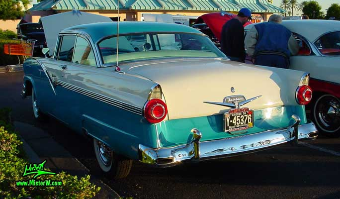 Photo of a white & turquoise 1956 Ford Fairlane 2 Door Hardtop Coupe at the Scottsdale Pavilions Classic Car Show in Arizona. Rearview of a 56 Ford Fairlane Hardtop Coupe