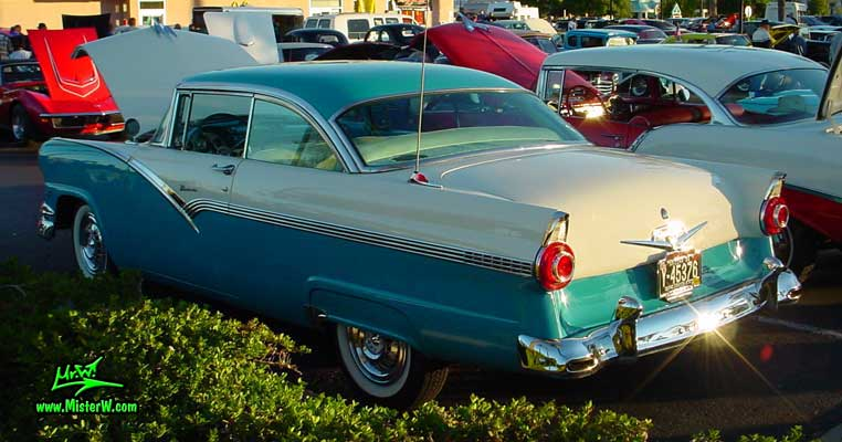 Photo of a white & turquoise 1956 Ford Fairlane 2 Door Hardtop Coupe at the Scottsdale Pavilions Classic Car Show in Arizona. Sideview of a Postless 56 Ford Fairlane Hardtop Coupe