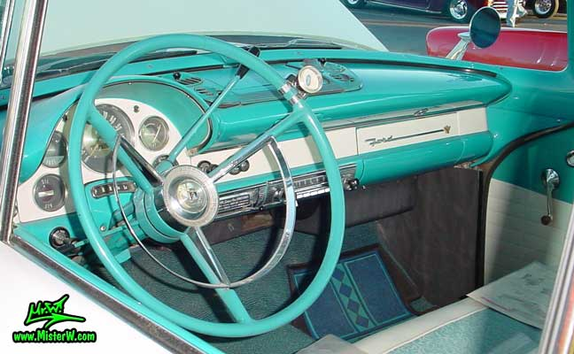 Photo of a white & turquoise 1956 Ford Fairlane 2 Door Hardtop Coupe at the Scottsdale Pavilions Classic Car Show in Arizona. Dashboard of a 56 Ford Fairlane