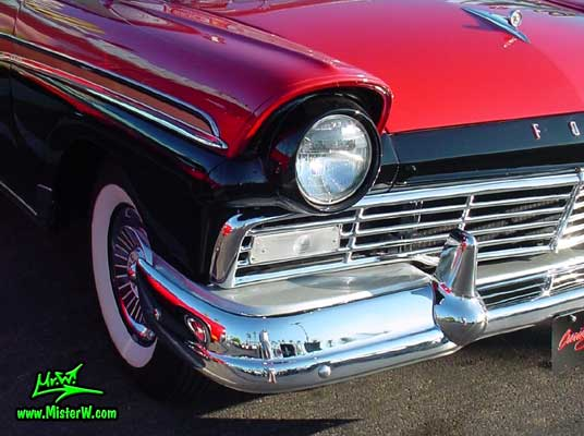 Photo of a red & black 1957 Ford Convertible at the Scottsdale Pavilions Classic Car Show in Arizona. 1957 Ford Head Light & Bumper