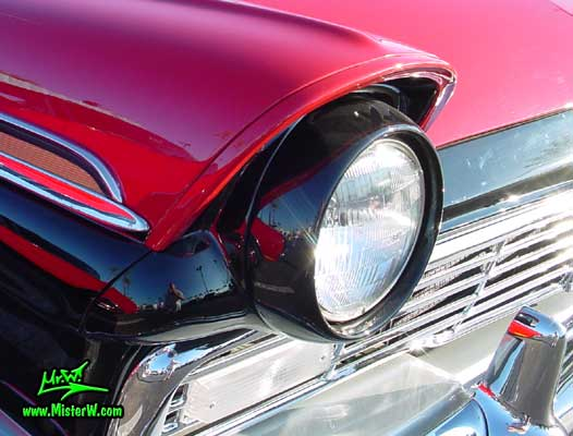 Photo of a red & black 1957 Ford Convertible at the Scottsdale Pavilions Classic Car Show in Arizona. 1957 Ford Headlight
