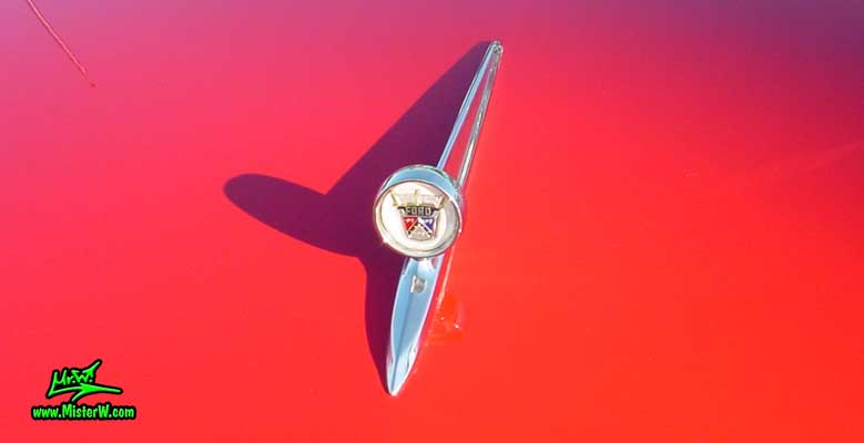 Photo of a red & black 1957 Ford Convertible at the Scottsdale Pavilions Classic Car Show in Arizona. 1957 Ford Hood Ornament