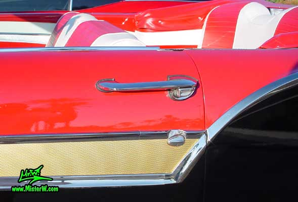 Photo of a red & black 1957 Ford Convertible at the Scottsdale Pavilions Classic Car Show in Arizona. 1957 Ford Door Handle