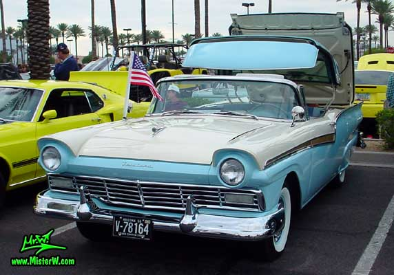 Photo of a white & blue 1957 Ford Fairlane Retractable Hardtop / Convertible at the Scottsdale Pavilions Classic Car Show in Arizona. 1957 Ford with the Hardtop opening