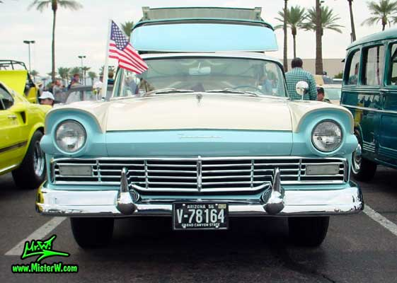 Photo of a white & blue 1957 Ford Fairlane Retractable Hardtop / Convertible at the Scottsdale Pavilions Classic Car Show in Arizona. 1957 Ford Retractable Front Chrome Grill